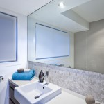 Luxury bathroom with wide mirrors and tap and sink